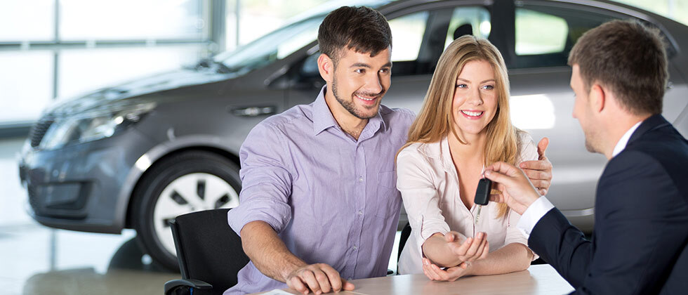 Couple purchasing a car