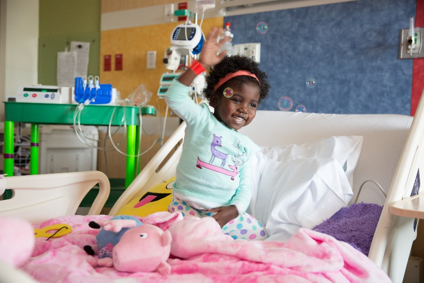 Young smiling child on hospital bed