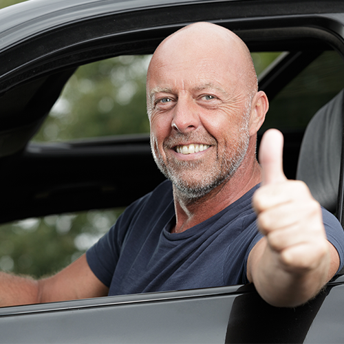 Middle aged man giving a thumbs up